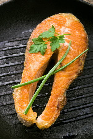 salmon steaks in the iron pan photo