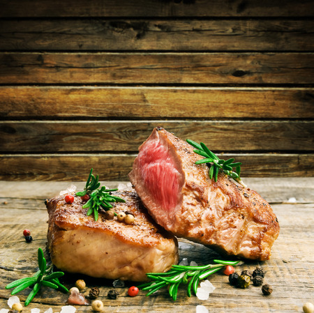 Beef steak on a wooden table photo