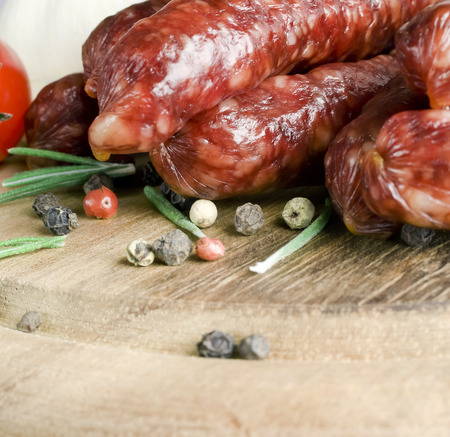 Smoked sausage with rosemary and peppercorns tomatoes and garlic photo