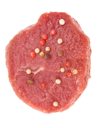 raw steak with pepper photo