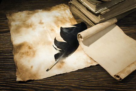 old papers on a wooden table photo