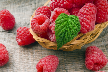 Heap of raspberries on a wooden background photo