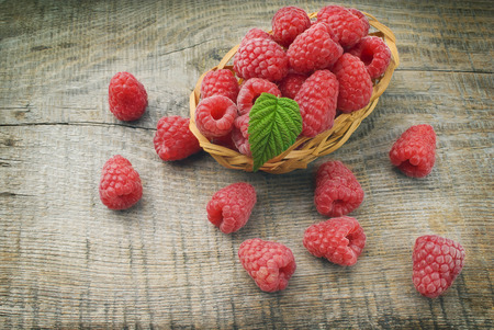 Heap of raspberry on a wooden background photo