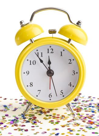 new year on a yellow alarm clock photo