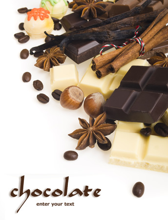 chocolates and spices on a white background photo