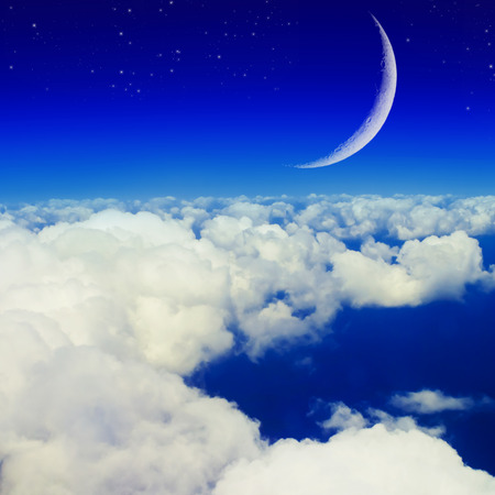 Blue sky, clouds and moon Stock Photo
