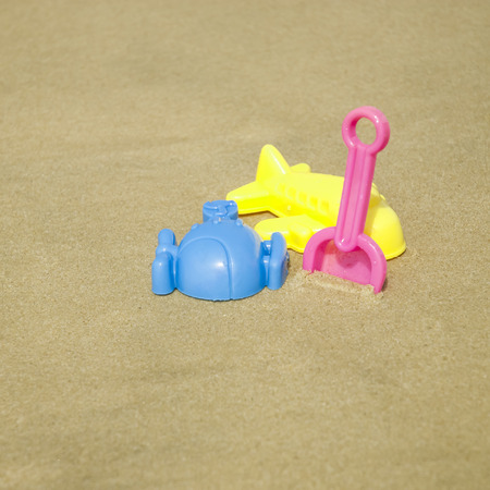 Summer kids beach toy in the white sand photo