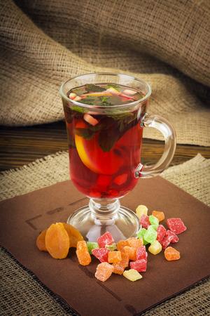 Hot drinks, red tea, mint photo