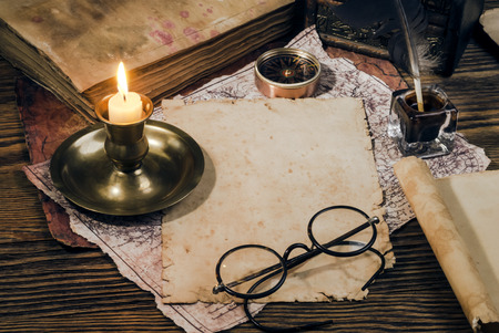 bifocals: old papers on a wooden table