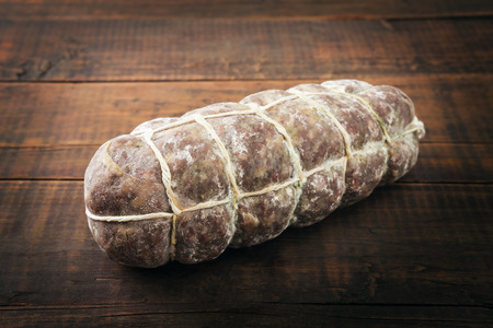 air dried: salami sausage on wooden background