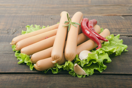 tine: Close up of sausage and fresh vegetables