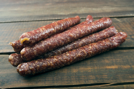 larder: dried sausages on old wooden table