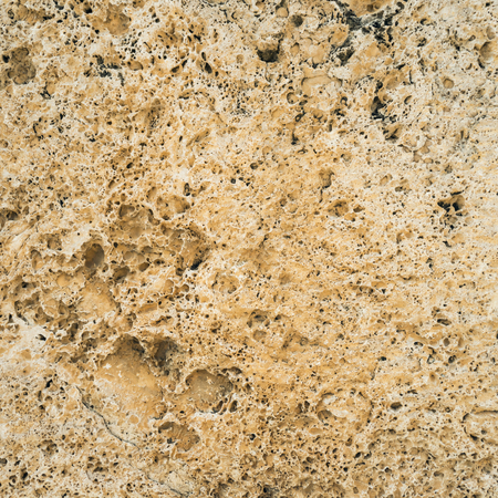 untreated: Brown granite texture. Natural rough untreated and unpolished stone wall with grain surface, abstract background
