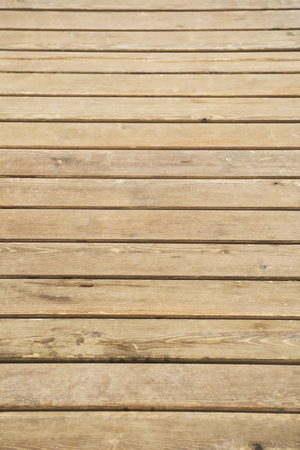 decking: Close up of composite decking. Wood planks. Kiln dried wooden lumber texture background. Timber hardwood wall.