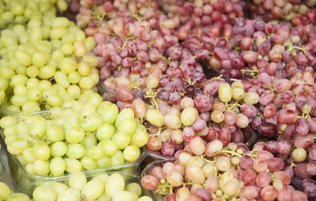 Grape. Wine grapes background. Grapes an market. It can be used as a food background (selective focus)