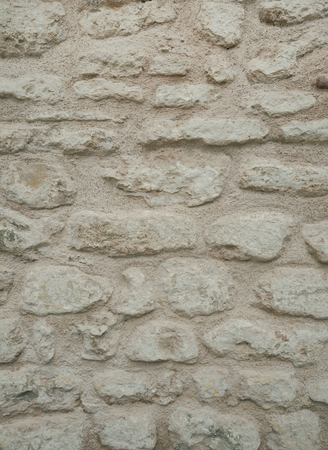 coquina: Old grunge brick gray wall background. Weathered urban texture, architectural detail pattern