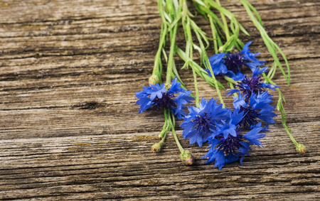 bouquet of blue cornflowers close-up on a wooden background