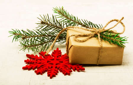 Christmas gift boxes with decorated fir tree branches