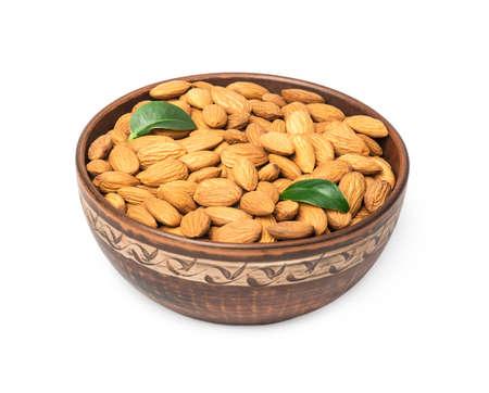 Almond nuts in bowl on white background Standard-Bild