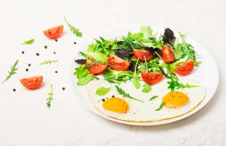 Breakfast - fried eggs and fresh vegetables.