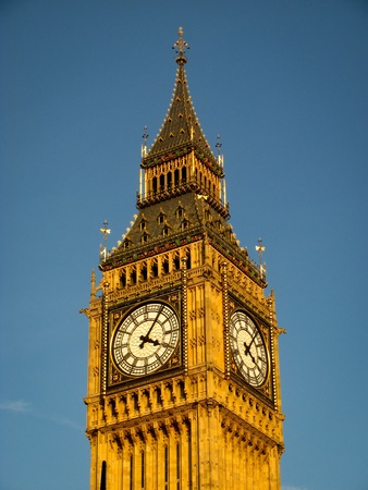 Big Ben - top of the tower with a clock with a blue sky on the background Stock Photo - 11879223
