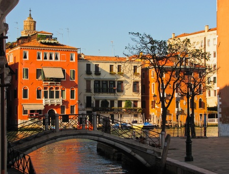 covered bridge': A typical street with canals in Venice, Italy