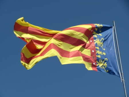 Flag of Valencia, which is located on the historic towe Stock Photo