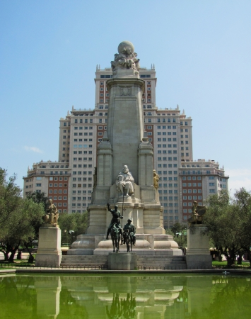 The monument of Miguel Cervantes on Plaza de Espana on August 20, 2012 in Madrid, Spain  The writer is accompanied by Don Quijote and Sancho Panza