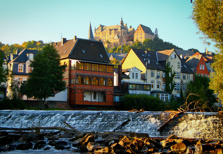 Old houses and the castle on top of a town in Marburg in Germany