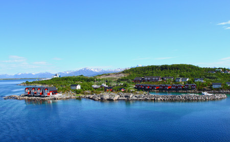 Typical Norwegian Fishing Village With Traditional Red Rorbu Huts, Lofoten Islands, Norway