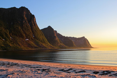 Midnight sun on a beach on Senja island, Norway Stock Photo