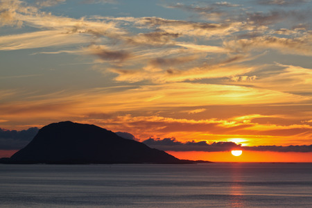 Sunset over island in Western Norway as viewed from Flora town Stock Photo