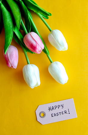 Happy Easter card with tulips on yellow background