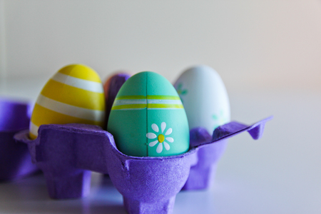Easter eggs in a purple box on white background
