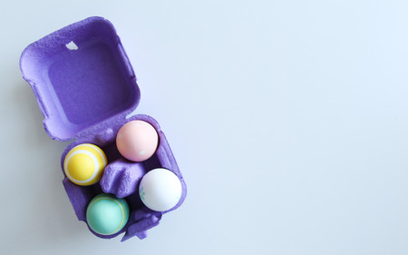 Easter eggs in a box on white background