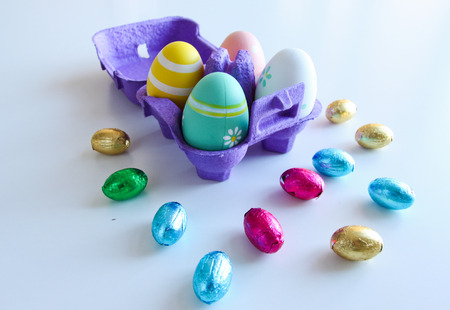 Easter eggs and Easter candy on a white background Stock Photo