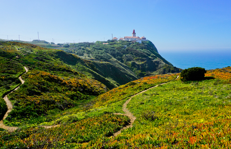 The lighthouse on the top of the cliff at Cabo da Roca (Cape Roca) the westernmost point of Europe near Sintra Portugal.
