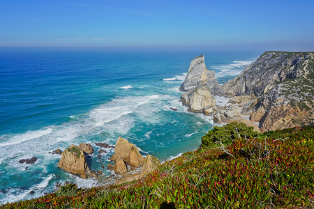 Ocean meets Cliffs of Cabo da Roca Cape Roca in Sintra - the westernmost extent of mainland Portugal and Europe 版權商用圖片