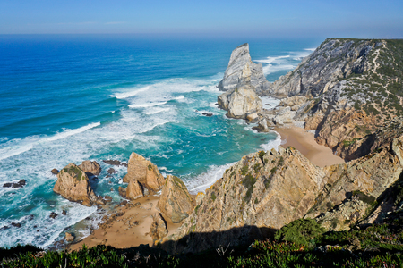 Ocean meets Cliffs of Cabo da Roca Cape Roca in Sintra - the westernmost extent of mainland Portugal and Europe Stock Photo