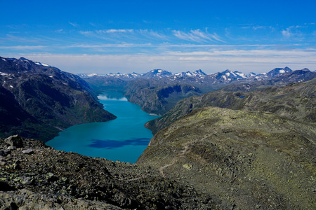Beseggen mountain ridge in Jotunheimen, Norway with blue sky and clouds