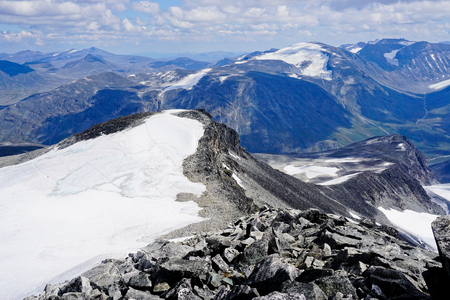 View from Galdhøpiggen, highest mountain in Scandinavia. Jotunheimen national park in Norway.