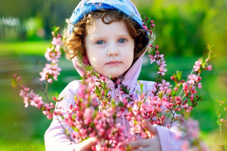 beautiful girl with flowers of almonds