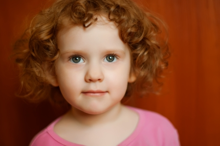 Portrait of the curly little girl