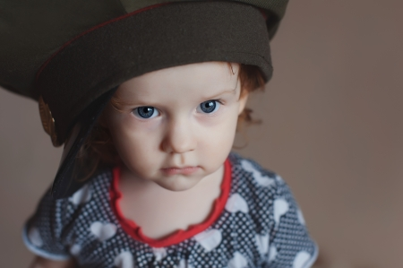 Cute little girl in a soldier s caps