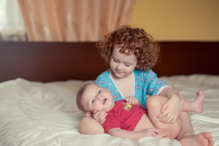 two kids on a bed photo