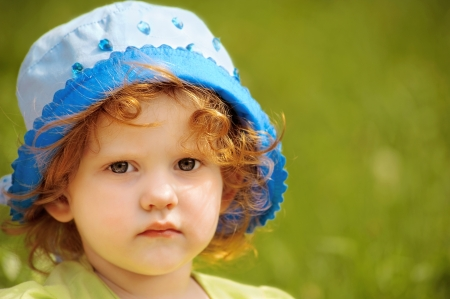 gray eyes: portret close up little beautiful girl in summer park Stock Photo
