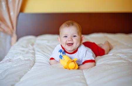 the small happy child smiles