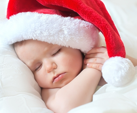 child in bed: small santa dream before Christmas