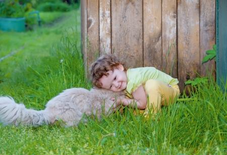 Tender moment between little girl and her feline friend