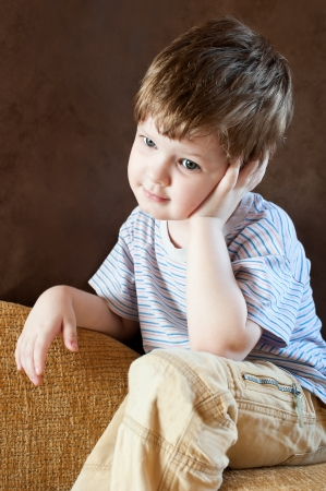 Portrait of a thoughtful little boy Stock Photo